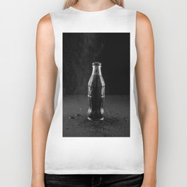 Glass bottle with carbonated drink under the drops of water. Biker Tank