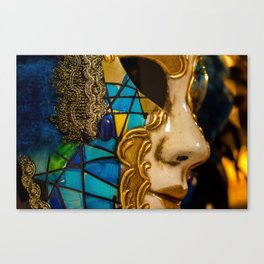 Close-up of a Venetian carnival mask with black and blue feathers. Canvas Print