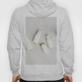 Various bottles of milk on grey concrete background Hoody