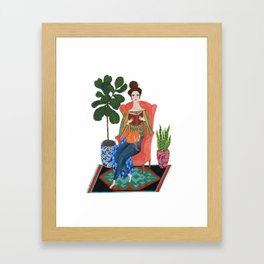 Cat lady reading Framed Art Print