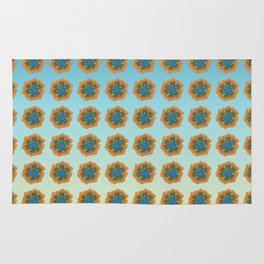 Orange flower on blue repeat Rug
