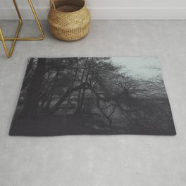 Tree, walking into the water Rug