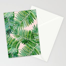 Green palm leaves on a light pink background. Stationery Cards