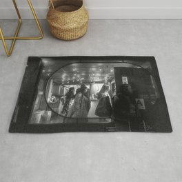 People getting out of a Place Rug