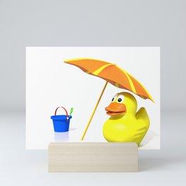 Rubber duck at the beach Mini Art Print
