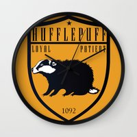 hufflepuff Wall Clocks featuring Hufflepuff Crest by machmigo