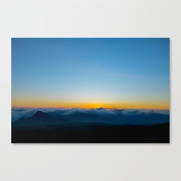 sunrise above the clouds Canvas Print
