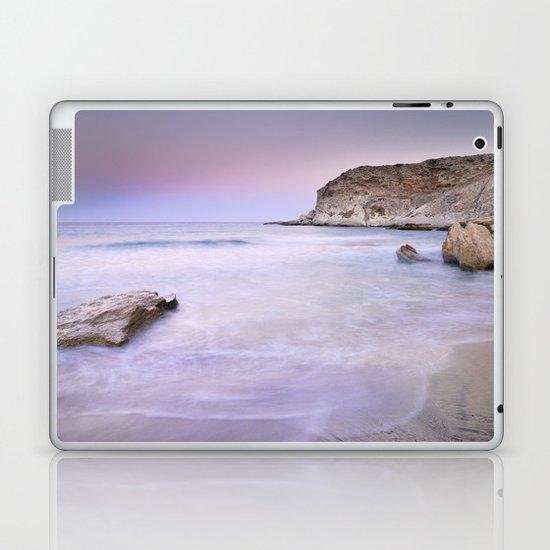 Pink sunset at the volcanic beach Laptop & iPad Skin