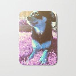 Blue dog on pink grass. Bath Mat