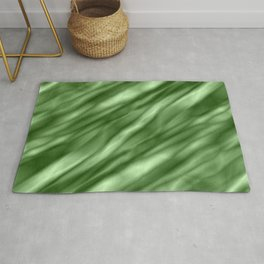 A interweaving cluster of green bodies on a violet background. Rug