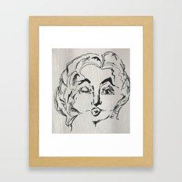 Winking woman Framed Art Print