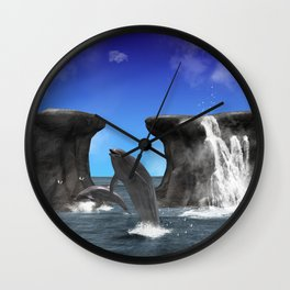 Dolphins swim and jump in the sea Wall Clock