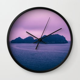 Cloudy Seascape in Shades of Purple. Rocky Island Obscuring the Horizon. Wall Clock