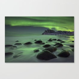 Aurora borealis over a beach on the Lofoten in Norway Canvas Print