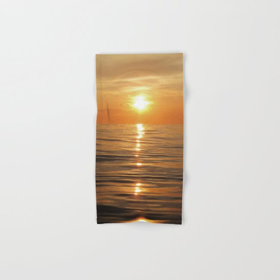 Sun setting over calm waters Hand & Bath Towel
