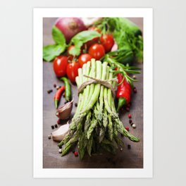 Fresh green asparagus bunch and vegetables on wooden board Art Print