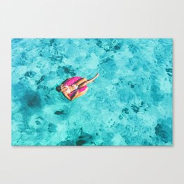 Drone aerial top view of beach vacation woman relaxing in donut float on turquoise ocean Bora Bora Canvas Print