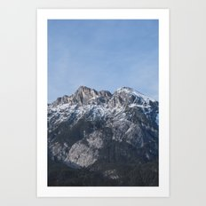 The snow on the mountains melts away on a sunny spring day in Austria. Art Print