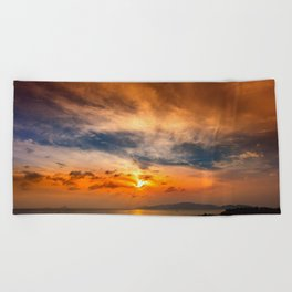 A Sunrise Glow Beach Towel