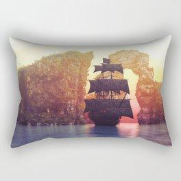 A pirate ship off an island at a sunset Rectangular Pillow