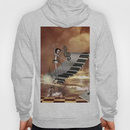 Cute girl dancing on a piano on the beach Hoody