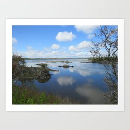 PUFFY CLOUD REFLECTIONS ON WATER AND ROCKS Art Print
