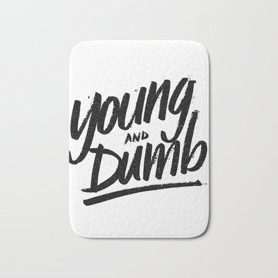 young & dumb Bath Mat