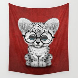 Cute Snow Leopard Cub Wearing Glasses on Deep Red Wall Tapestry