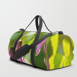 Purple clematis flowers in the sun Duffle Bag