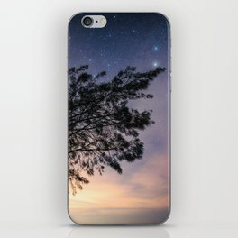 Amazing starry scene. Silhouette of a tree with colorful starry sky. iPhone Skin