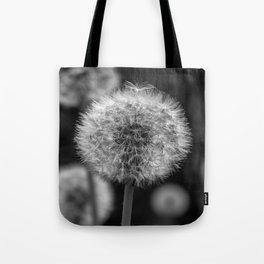 Monochromatic dandelion on black Tote Bag
