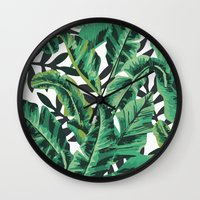 banana leaf Wall Clocks featuring Tropical Glam Banana Leaf Print by Nikki