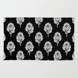 Linocut Protea flower printmaking pattern black and white floral Rug