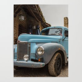 Historic blue-colored pickup parked in the streets of an historic Italian village Poster