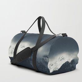 Darkness and light on snow covered mountains Duffle Bag