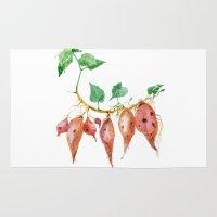 potato Area & Throw Rugs featuring Sweet potato by Ksenia Sapunkova