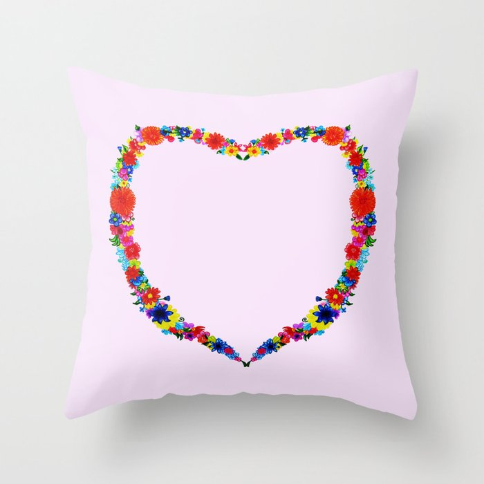 heart made of flowers on a pink background Throw Pillow