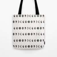 moon phases Tote Bags featuring Moon Phases by Andre D