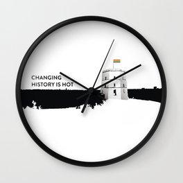 Tower with rainbow flag Wall Clock