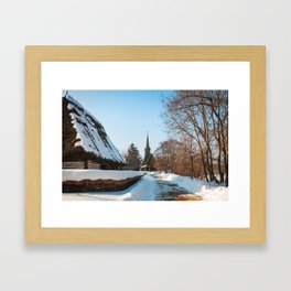 Heavy snow on a street in a traditional Romanian village Framed Art Print