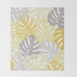 Yellow monstera deliciosa leaves Throw Blanket