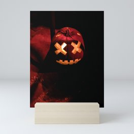 Photograph of a Scary, Carved Pumpkin Lit from the Inside at Halloween Mini Art Print