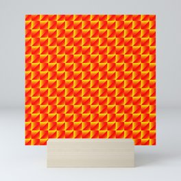 Chaotic pattern of yellow rhombuses and red pyramids in a zigzag. Mini Art Print