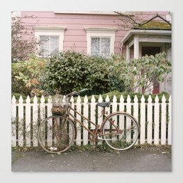 The Bicycle and Pink House Canvas Print