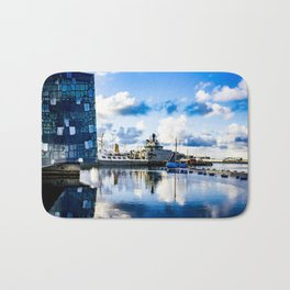 View of Boats on the Sea behind the Harpa Concert Hall in Reykjavik, Iceland Bath Mat