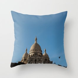 Bird flying by the Sacre Coeur Throw Pillow