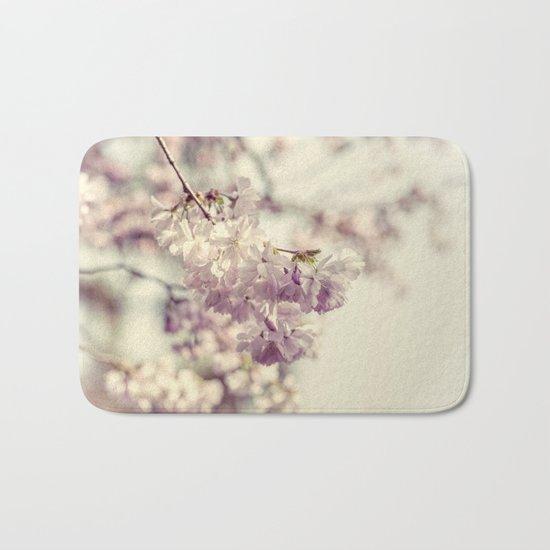 Cherries in bloom Bath Mat