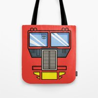 optimus prime Tote Bags featuring Transformers - Optimus Prime by CaptainLaserBeam