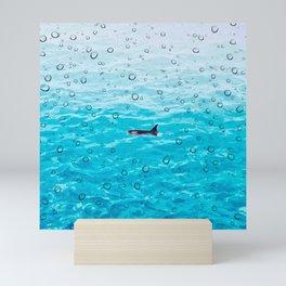 Orca Whale gliding through the water on a rainy day Mini Art Print