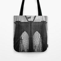 brooklyn bridge Tote Bags featuring Brooklyn Bridge by Nicklas Gustafsson